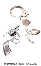 Handgun and handcuffs isolated over white background