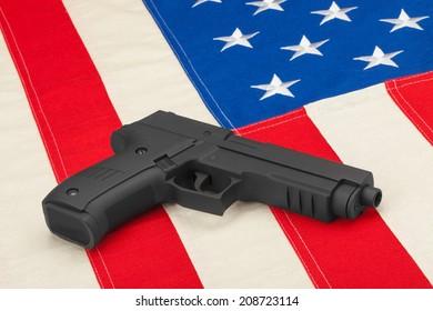 Handgun laying on USA flag - studio shoot
