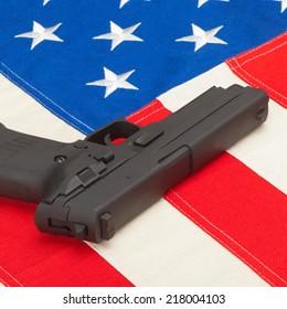 Handgun laying over USA flag - studio shoot - 1 to 1 ratio