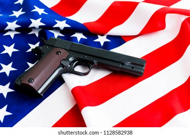 Handgun lying on USA flag.