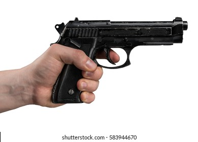 Handgun in male hand isolated on black background