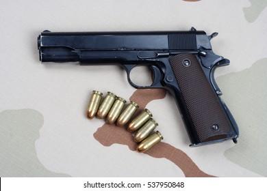 handgun on army uniform