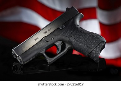 handgun on black with flag