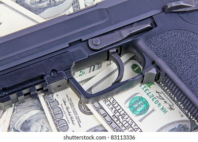 Handgun on dollar notes