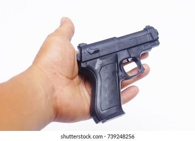 Handgun On Hand Over White Background
