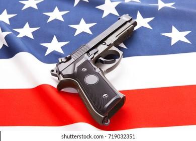 Handgun over satin USA flag - studio shoot