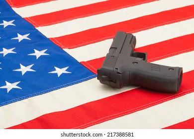 Handgun over USA flag - studio shoot