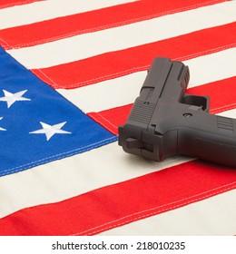 Handgun over USA flag - studio shoot - 1 to 1 ratio