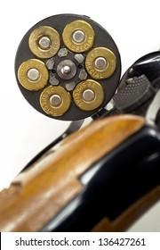 A handgun revolver chamber is open showing ammunition gun ammo personal weapon
