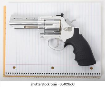 Handgun with school notebook paper.