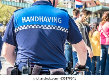 The handhaving police department having a look in the streets of Amsterdam, Netherlands