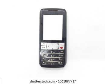 Handheld Black Silver Metallic Color Vintage Retro Old Broken Used Mobile Phone with Keypad for Messaging and Call only in White Isolated Background