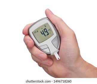 Handheld blood sugar monitor isolated on white.