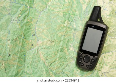 A handheld GPS unit sits on a topo map.  The blank screen is ready for your text.