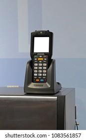Handheld Laser Barcode Reader and Scanner at Charger Dock