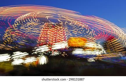 Handheld long exposure of a fair ride at night.