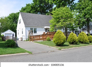 Handicap Ramp Middle Class Suburban Cape Cod Home in Residential Neighborhood