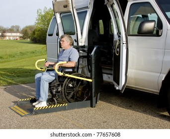 handicap van with a man in a wheelchair on a lift