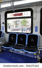 HANDICAPPED AND INVALID SEATING ON A PUBLIC BUS - CIRCA 2014 - Priority seating for elderly and the disabled on a bus