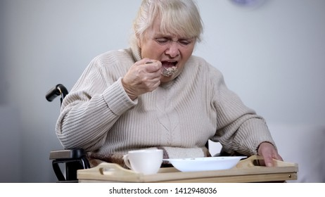 Handicapped lady reluctantly eating dinner in medical center, inappropriate care