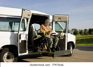 handicapped man operating a wheelchair lift van