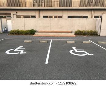 Handicapped Parking Spaces at Office Building. symbol car park. Handicapped parking spot - transportation infrastructure road markings