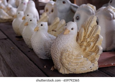 Handicraft of bird clay doll, popular decoration dolls place in a garden décor store, famous export product from Asian countries