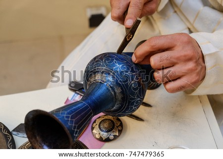 Handicraft expert demostrating his skill of making Moroccan iron works