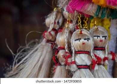 handicraft keychains. handicraft keychains made with jute. jute doll keychains.