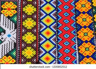 Handicraft work Huichol indigenous people of Mexico.