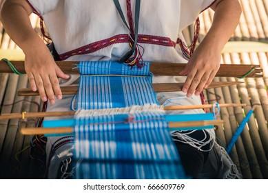 Handicraft work product, Woman weaving silk sari on his laps.