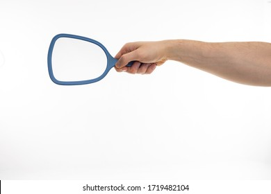 A handing holding a blue mirror on a white background.