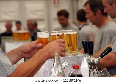 handing over beers during an open door day of Van Gool meatfactory in Achterbroek, Antwerp/Belgium - September 9 - 2012