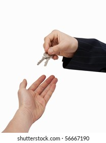 Handing over the Keys [with Clipping Path and isolated on white background] Hand of businessman passing a set of keys to another hand.