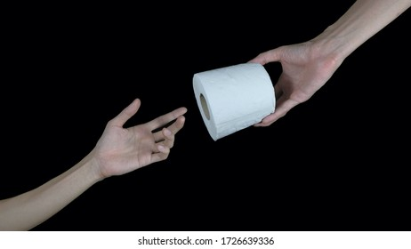 Handing Toilet paper roll to someone on black background