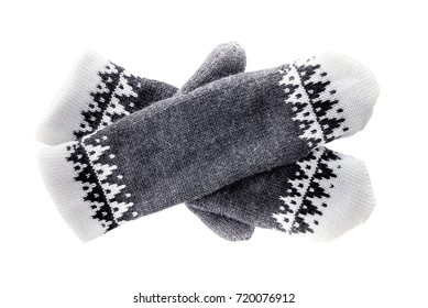 Hand-knitted mittens isolated on white background.