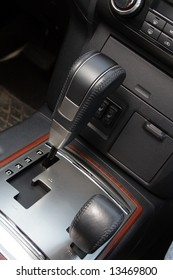 The handle of an automatic gear change in an off-road car