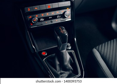 Handle of automatic gearbox transmission. Modern car interior at the evening