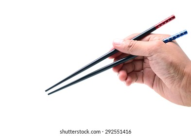 Handle Chopsticks held in a male hand on white background