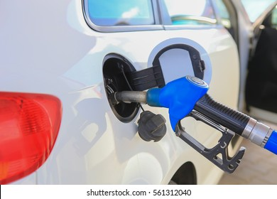 handle of the filling gun in car gasoline tank