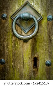 Handle And Keyhole Of Closed And Locked Ancient Wooden Church Door