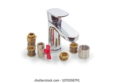 Handle mixer tap and several brass and steel pipe couplings, adapters, nuts and ball valve on a white background