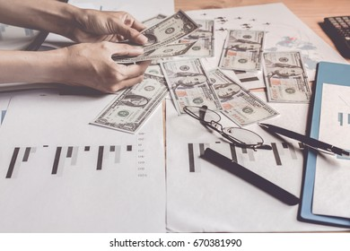 Handle money bank United States Dollars working behind graph shows plans problem of corruption.