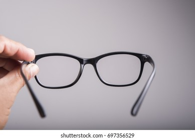 Handle of old glasses on gray background