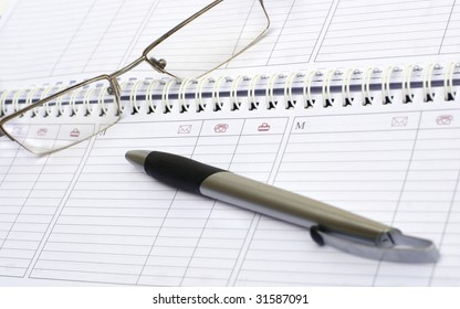 The handle and points lie on a weekly journal