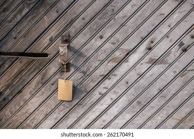 Handle and Tag on a Slanted Wooden Background