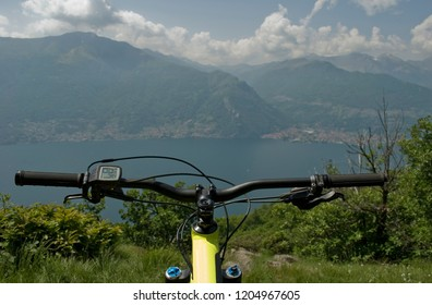 handlebar and display of yellow electric bicycle, e-bike, ebike, mountain, lake of Como, summer, sport, adventure, freedom, sun, alps, Lombardy, Italy