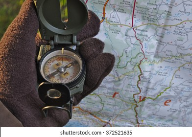 Handling a military compass and map. Survival, outdoors and military theme