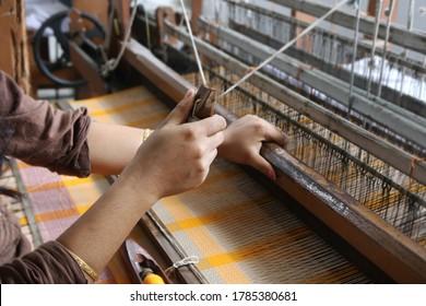Handloom weaver in India working in her loom