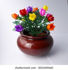 Handmade acrylic flowers craft , beauty colorful in clay pot isloated on white